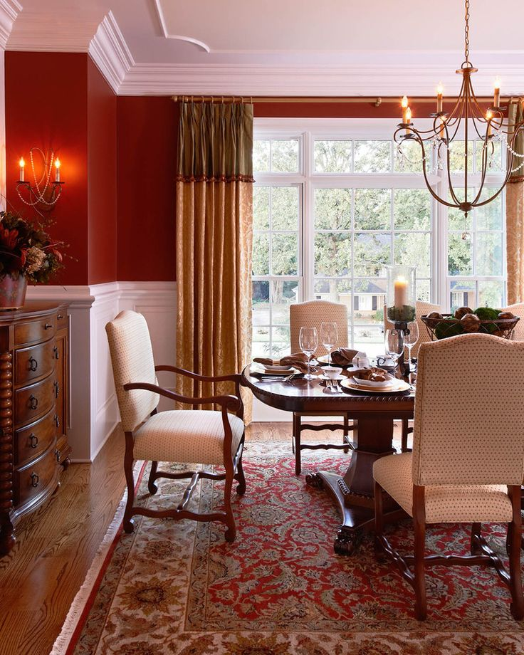cozy red dining room persian carpet chair rail half red white wall gold curtains better decorating bible blog