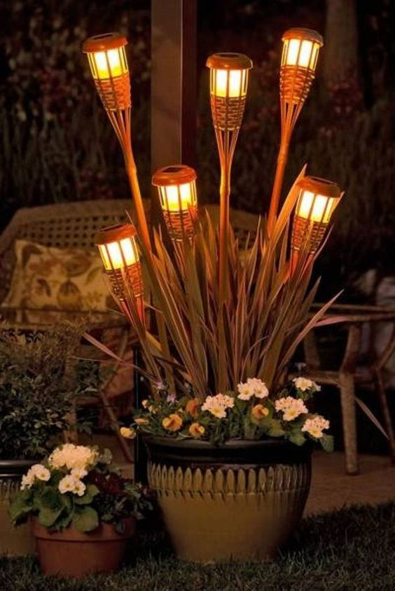 A DIY 'Tiki Torch Bouquet' in a planter is a festive, fun and budget-friendly way to light-up your deck for an evening party.