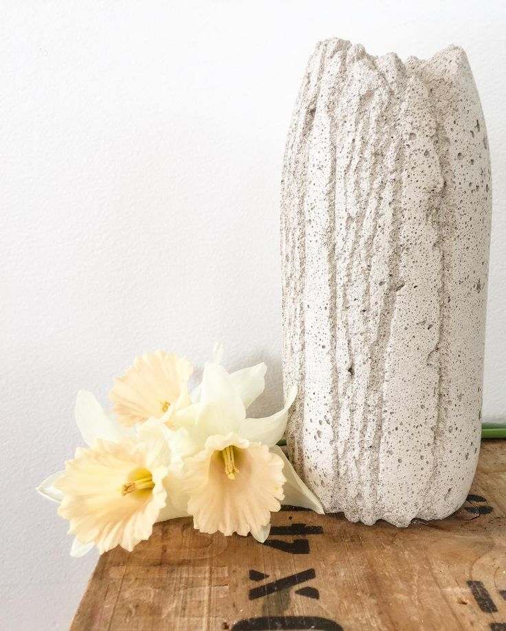 So stoked with my concrete vase! Totally infatuated with this amazing material. Did you know concrete can be smoothed, textured, carved into any shape... this one reminds me of alpine rivers carved into metamorphic schist with rugged peaks. Inspired by South Island, New Zealand. Teamed up with lovely apricot daffodils from my own garden ❤️feels awesome #southland #nzdesign #kariwylde #spring2016 #daffodils #concreteart #concrete #vase #minimal