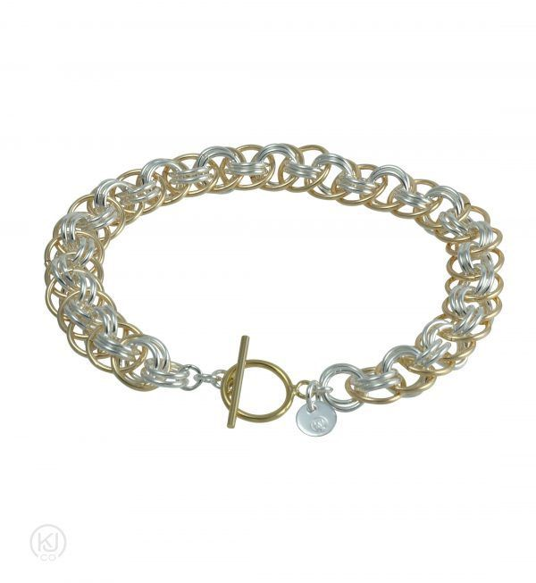 This simple yet striking weave consists of large orbiting rings layered over the interlocking smaller rings at the core of this bracelet. Each ring has been hand coiled out of Sterling Silver or 14kt Gold Filled wire, cut and woven together to create this remarkable and ageless beauty. The Aylin – Viper Basket Weave Bracelet is available in Sterling Silver or 14kt Gold Filled combined with Sterling Silver