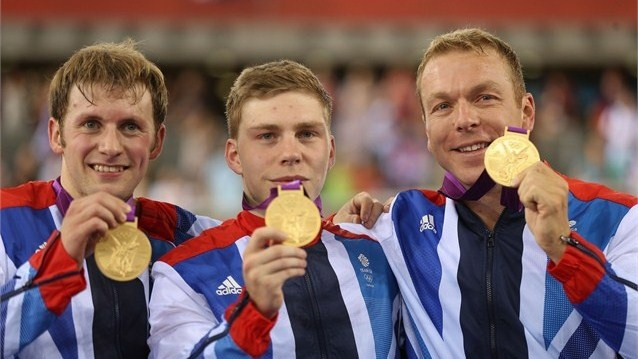(L-R) Philip Hindes, Jason Kenny and Sir Chris Hoy of Great Britain celebrate with their gold medals during the medal ceremony after setting a new world record in the Men's Team Sprint Track Cycling final on Day 6.