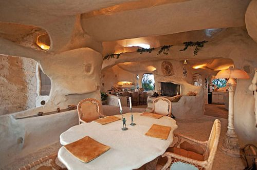 Dick Clark owned a Flintstones-inspired home,which he put on the market just weeks before he diedfor 3.5 million. This just goes to show how how awesome he really was.: Dining Rooms, Unusual Home, The Real, Living Room, Hobbit Houses, Flintstone Houses, Dick Clarks, Malibu California, Man Caves