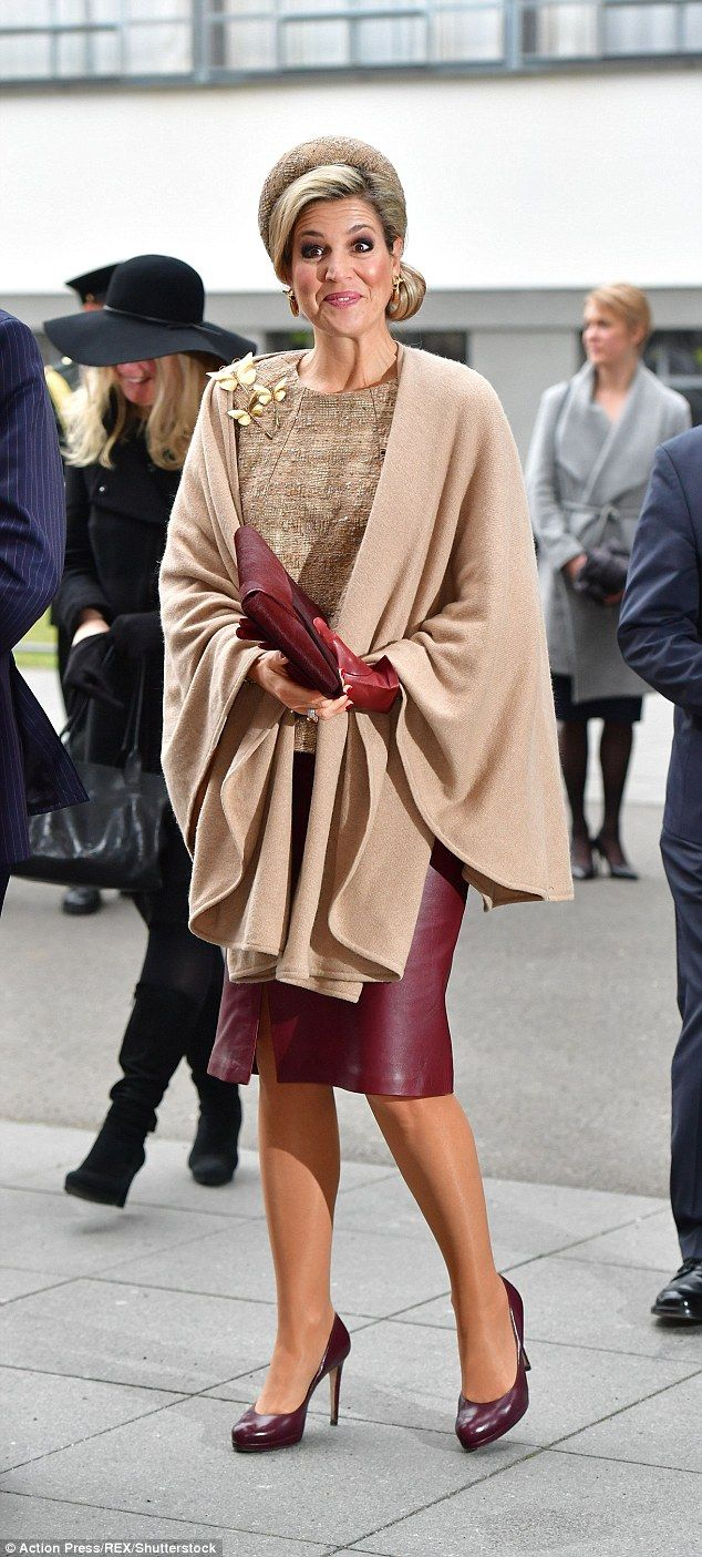 The Dutch Queen wore her trusty taupe cape over the plum leather pencil skirt today