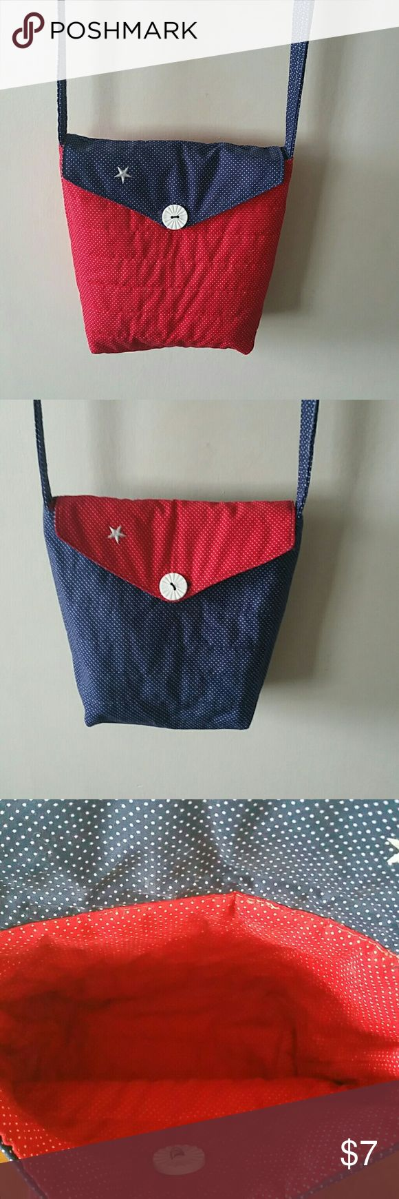 HANDMADE QUILTED REVERSIBLE BAG HANDMADE QUILTED  REVERSIBLE BAG,  SHOULDER  HANDLE  19IN CHINA DROP, 10 INCHES WIDE, 91/2 INCHES DEEP, RED & BLUE WITH WHITE BUTTON,  STAR IS ONLY GLUED ON MAY COME OFF IF WASHED  BUTTON  CLOSURE. HANDMADE QUILTED  Bags Shoulder Bags