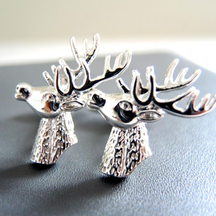 Stag's Head Cufflinks Our silver Stag Head Cufflinks make an excellent gift for gentlemen. They are great for a groom, make excellent groomsmen and ushers gifts and are a fabulous additi - The Alphabet Gift Shop