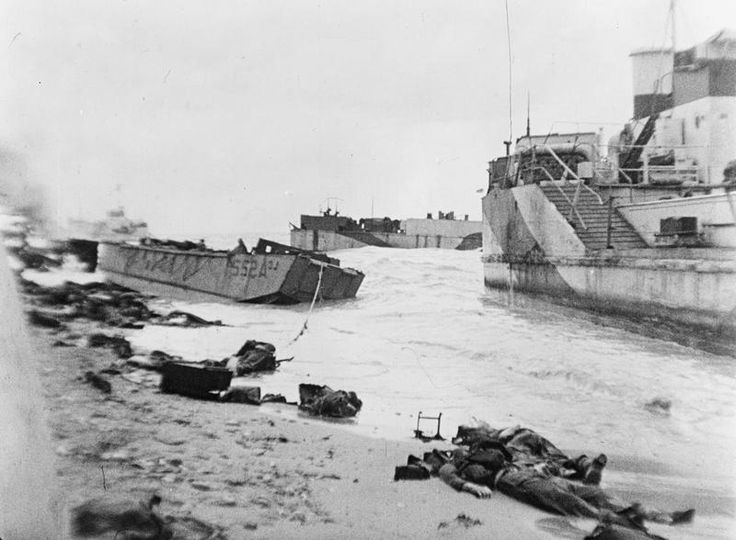 Bodies and beached landing craft in front of the sea wall on Nan Red beach, Juno area, near St Aubin-sur-Mer, 6th June 1944. LCT 518 is on the right. LCA 522 on the left. [[MORE]] This section was assaulted by men of: • The North Shore (New...