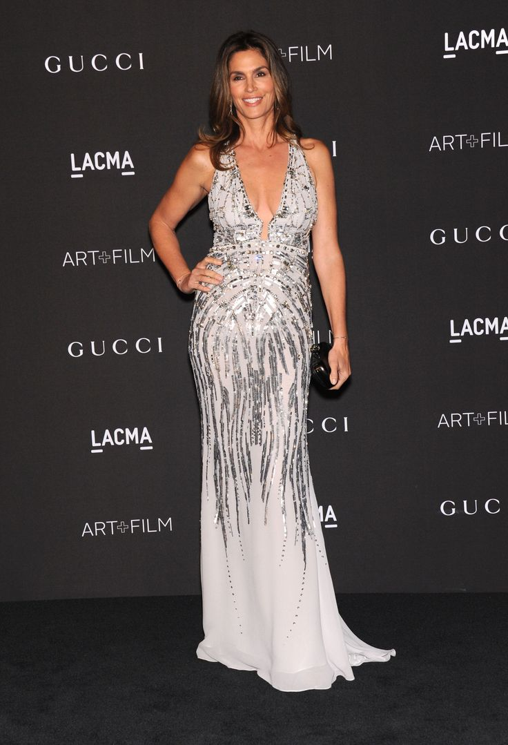 Stunning as ever, Cindy Crawford wore a dazzling #RobertoCavalli gown at '2014 LACMA Art' in Los Angeles.