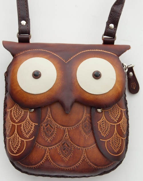 Hand made leather owl purse.  Adorable and nice details.