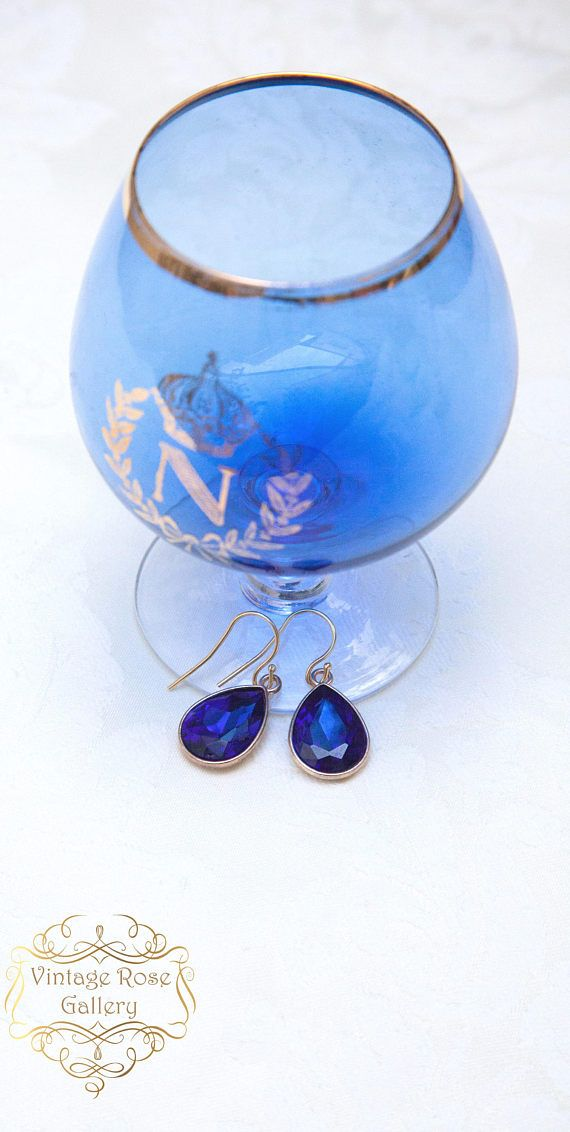 Sapphire Blue Crystal Earrings, Classic style earrings, Teardrop Crystal Earrings, golden plated 925 sterling silver ear hooks . A beautiful pair of classy and classic teardrop earrings. Features :Blue oval crystals into gold plated brass settings . With golden