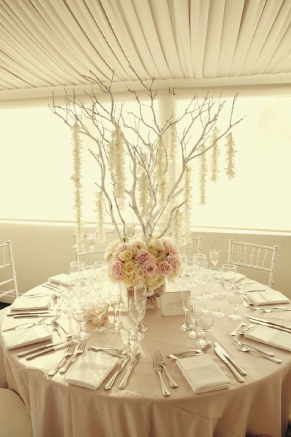 Too much white but love the concept of flowers at the bottom.  Would add crystal bling hanging from the branches.