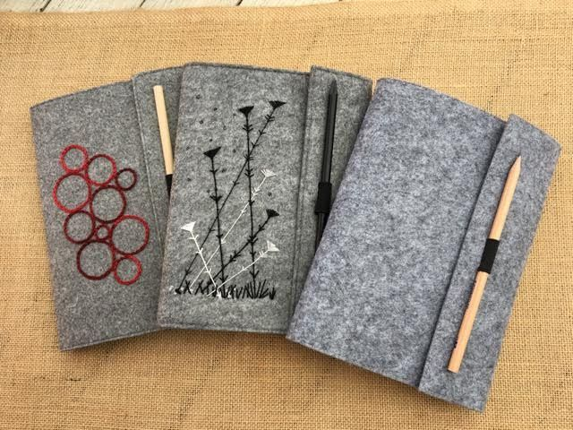 Learn how to create embroidered notebook covers