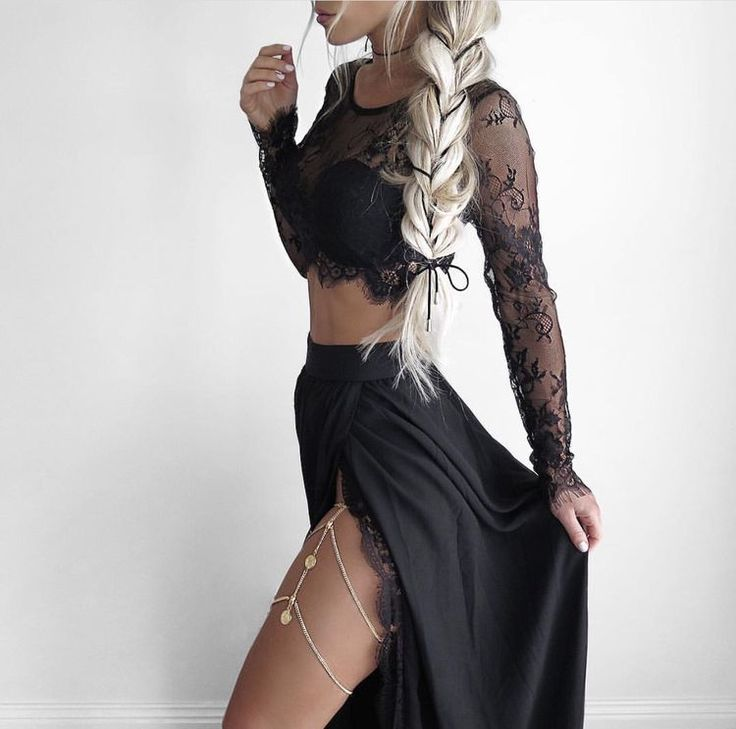 Black Crop top with lace long sleeves, a long black skirt with a slit, and a thigh chain