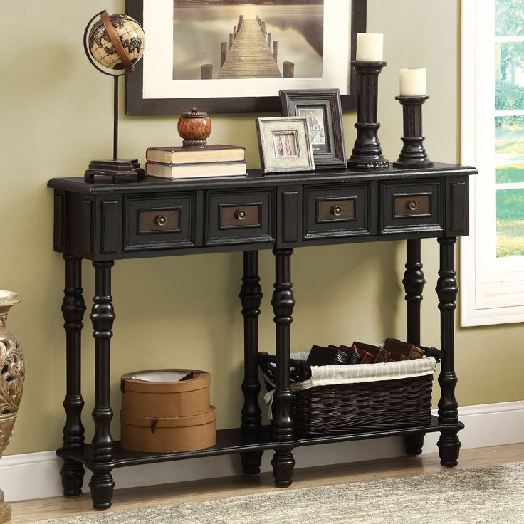 Monarch I 388 48 in. Veneer Traditional Console Table Item # HN-MON763 An elegant black and cherry stained finish carries a deep traditional styling. Assembly required. Dimensions: 48W x 12D x 34H in $391.