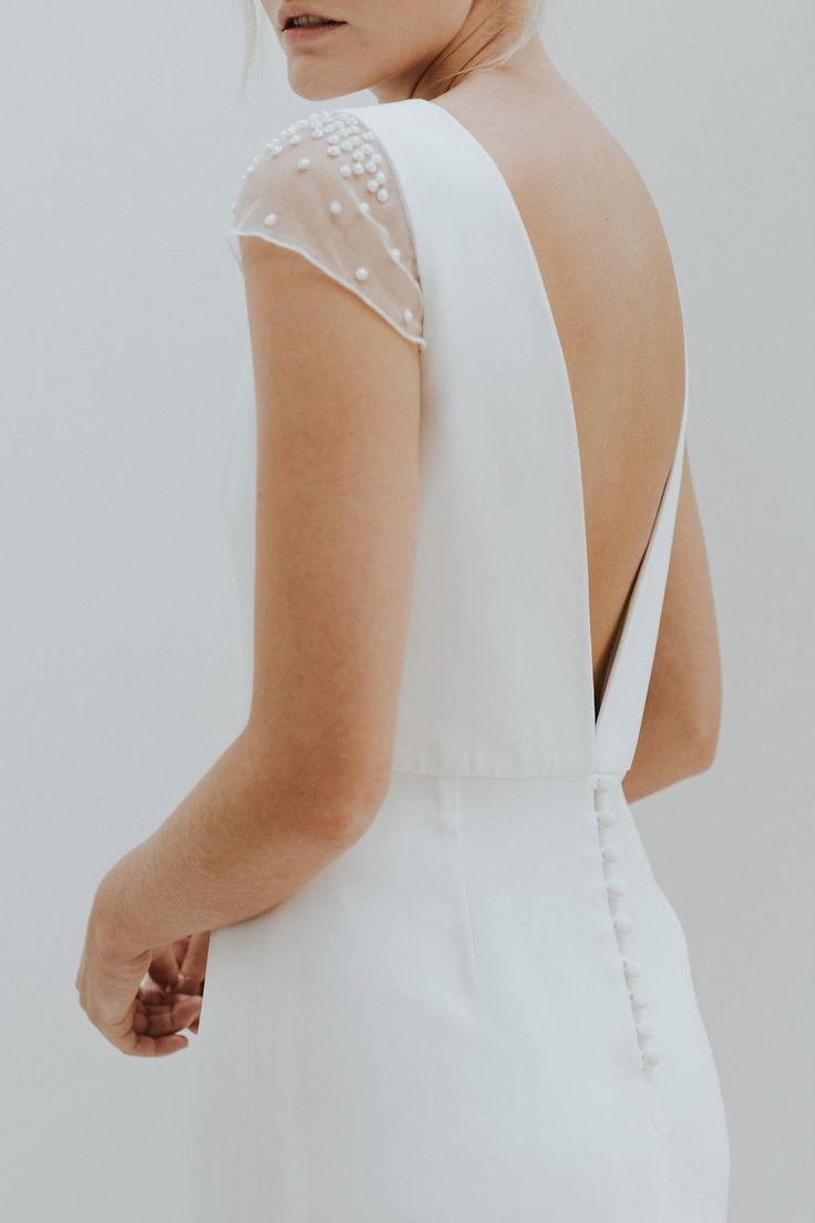Open V back wedding dress with hand embroidered cap sleeves by Charlotte Simpson