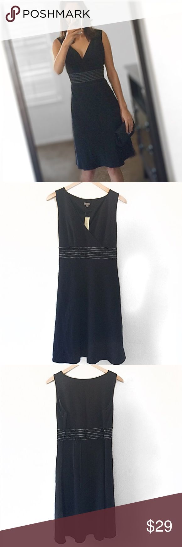 """ANN TAYLOR petite Black dress New with tags Ann Taylor petite dress size 14P. Wrap alike top, side zipper. Lined, it has empire waist design with waist straps to adjust the waist line.Dimensions: Bust: 20.5"""", waist: 18"""", length from shoulders: 35.5"""". This dress is absolutely gorgeous! 💛bundle and save💛 Ann Taylor Dresses Midi"""