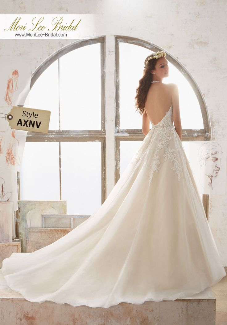 Style AXNV Maryann Wedding Dress  Alençon Lace AppliquéŽs with DiamantŽ Beading Cascade Down the Halter Neckline and Bodice of This Tulle Wedding Gown. A Delicate Jewel Encrusted Waistline Accents the Natural Waist. Colors Available: White, Ivory, Ivory/Champagne. Shown in Ivory/Champagne.