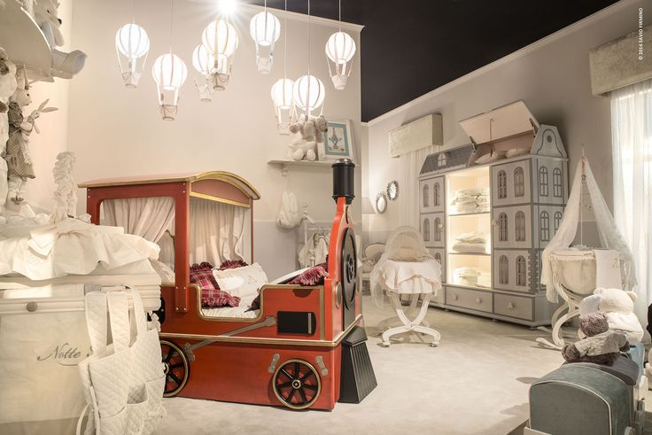 A funny tigerlily red train bed is the new proposal NOTTE FATATA by SAVIO FIRMINO for your #children #furniture #design #dream #fun
