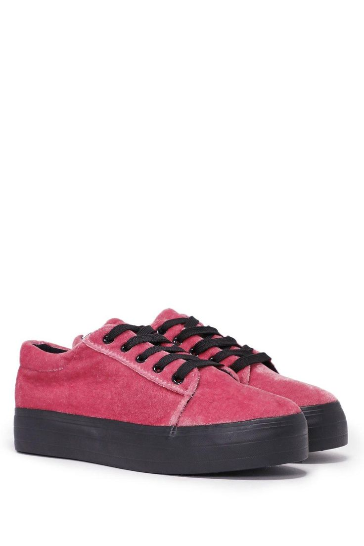 Crush your competition. This sneaker comes in crushed velvet and feature a lace-up closure and contrast platform sole.