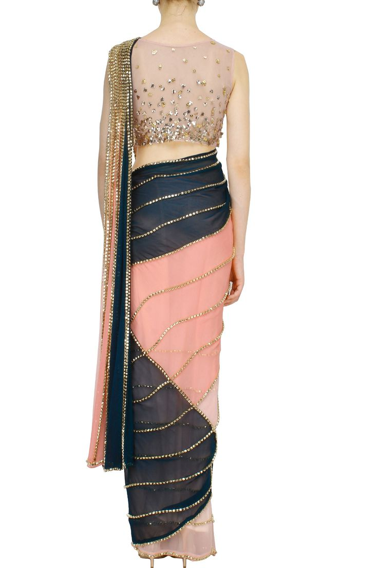 Bottle green and coral saree with peach blouse More