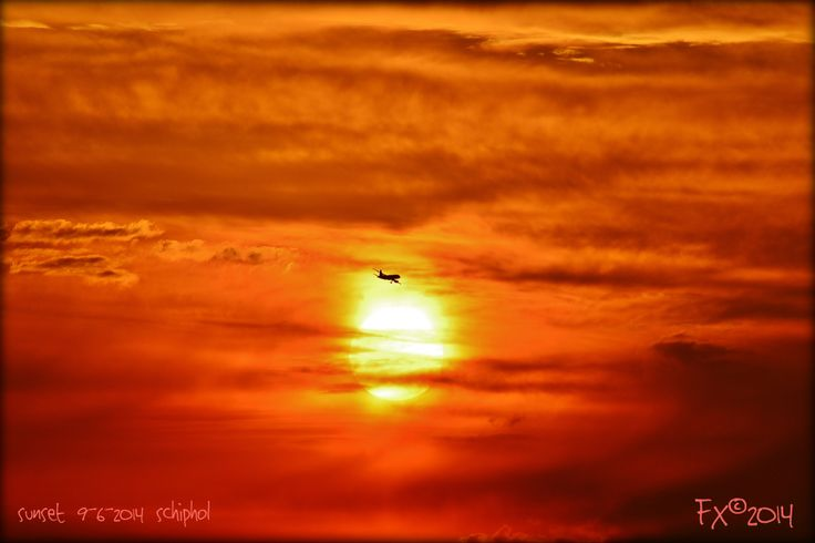 airplane in sunset orange skies near Schiphol Airport Amsterdam