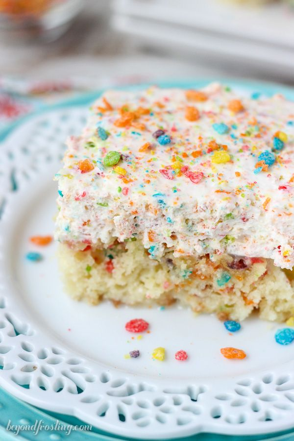 This Fruity Pebble Cereal Milk Poke Cake is a Fruity Pebble filled vanilla cake, soaked in sweetened condensed milk and topped with a Fruity Pebble Whipped Cream.