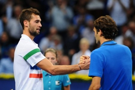 Benoit Paire and Roger Federer shake hands after their quarterfinal match in Basel (Benoit Paire blog)