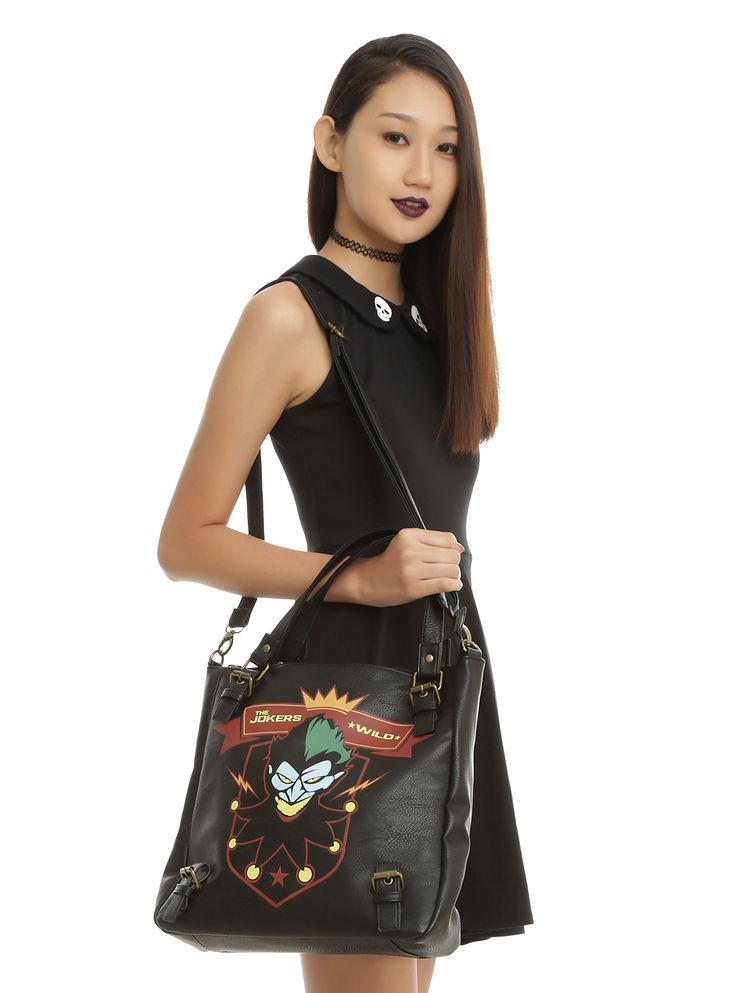 """<p>Faux black leather bag from DC Comics Bombshells with a <i>Harley Quinn</i> inspired """"The Jokers Wild"""" logo design - just like the one on her bomber jacket! Features buckle details, brass tone metal hardware, interior zipper pocket and zipper closure. Includes adjustable shoulder strap.</p>  <p>Hot Topic exclusive!</p>  <ul> <li>Approx. 13"""" x 13""""</li> <li>7"""" straps</li> <li>90% PU; 10% polyester</li> <li>Imported</li> </ul>"""