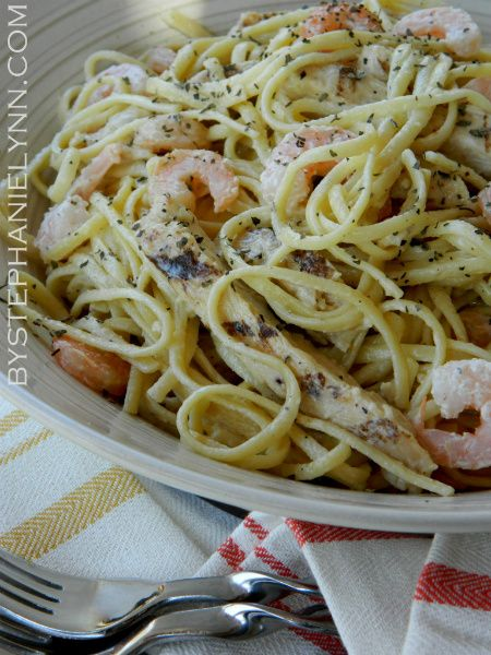 "Outback Steakhouse-inspired chicken and shrimp pasta...quick and easy---  I made this last night for dinner and it was great. Not so sure about the ""quick""  part but it was most-definitely delish! The 4 of us devoured it!  I added some cayene pepper and next time will add some red pepper flakes. Just a hint. *E*"