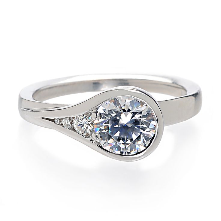 Modernly Designed, This Artistic Engagement Ring Features A Teardrop Shaped  Bezel Setting With Three