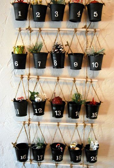 Blogger Caroline used floral foam and number stickers to turn buckets from Dollar Tree into a bucket-and-branch Advent calendar. Get the tutorial at The Feminist Housewife.