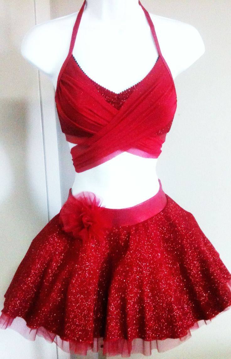 Custom made dance costume. Half top with crossover mesh ties. Separate circle skirt with crinoline and attached shorts. www.myowndesign.ca