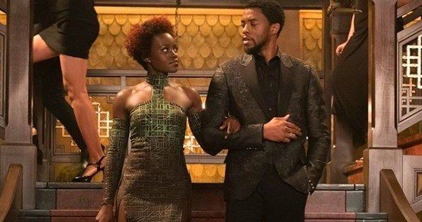 Black Panther Image Rings in the New Year with Style -- T'Challa and Nakia are ready to celebrate the New Year right in the latest look at Marvel's Black Panther. -- http://movieweb.com/black-panther-movie-photo-happy-new-year-2018/