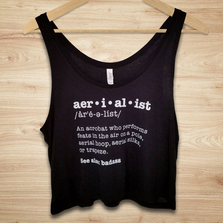 """Aerialist definition crop top, perfect for pole dancers and aerial fitness enthusiasts!  Shirt reads: """"Aerialist - an acrobat who performs feats in the air on a pole, aerial hoop, aerial silks, or trapeze. See also..."""""""