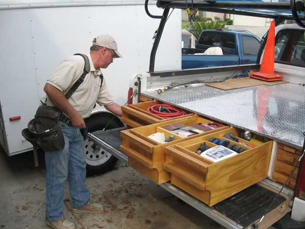 Back in 1989 I was working as a carpenter in the Ventura / Ojai area of Southern California, and my boss, Bob Thurman, and my co-worker, Brent Coffey, both had work trucks set up with pull-out tool...
