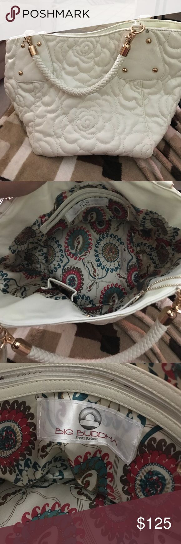 Big Buddha Pocketbook Brand New Never Used Big Buddha White Pocketbook with attachable strap. The outside is a white flower design with rounded gold studs. The inside has a multicolor design with 3 pockets, one with a zipper. Big Buddha Bags Shoulder Bags