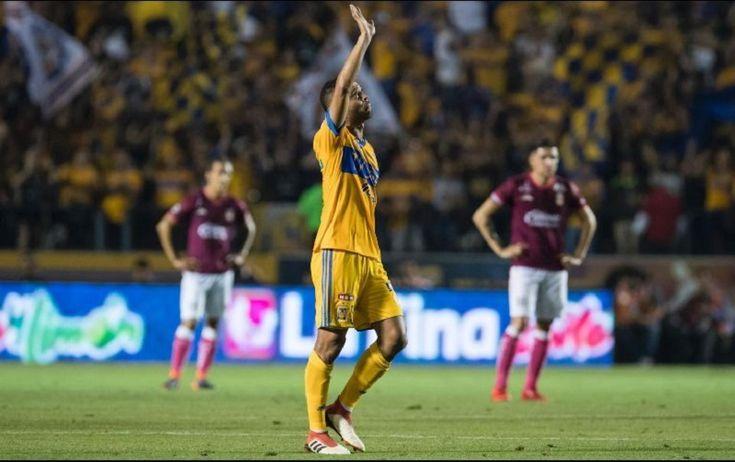 Con apuros, los Tigres de la UANL llegaron a 22 partidos sin perder en el estadio Universitario, luego de que anoche derrotaron 2-1 a Monarcas Morelia, en el partido correspondiente ...