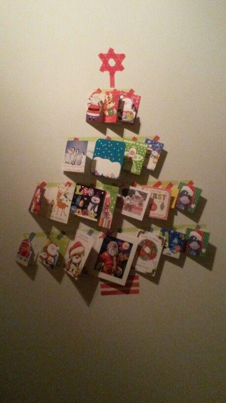 Kerstboom van washi tape en kerstkaarten, best leuk geworden!