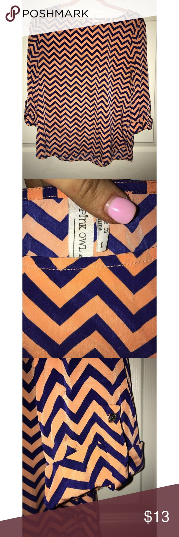 Navy Blue and Orange Chevron Blouse Navy Blue and Orange Chevron Blouse. Yes, it's navy blue!! I know it looks black in the pictures. I got it at a boutique where I live. Been maybe twice. Looks new Pink Owl Tops Blouses