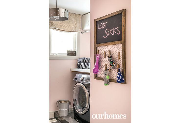 "Pale pink creates a cheery laundry room. Finding lost socks is a fun and functional task with a farmhouse chic holder.    See more of this home in ""Designer Delivers Room After Room of Creativity"" from OUR HOMES York Spring 2017:  http://www.ourhomes.ca/articles/build/article/designer-delivers-room-after-room-of-creativity"