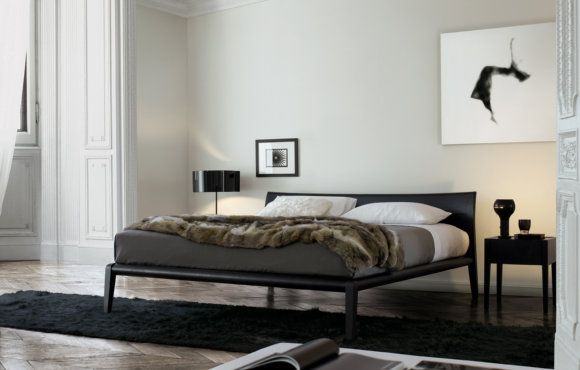 Poliform - Memo Bed    by Carlo Colombo (2006)  Memo, designed by Carlo Colombo. Inspired by traditional shapes and beds of the past, with its thin shapes and discreet structure. But the touch of craftsmanship in the finishing of the headboard, design of the legs, and elegant curve of all the elements make it a unique piece of extremely high value.