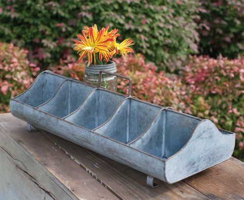 We are so pleased to be able to offer this awesome caddy. Metal feed trough style item with ten separate compartments. This can be used to plant an herb garden, to organize buttons or other craft item
