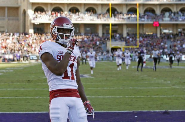 Oklahoma's Dede Westbrook (11) celebrates after scoring a touchdown during a college football game between the University of Oklahoma Sooners (OU) and theTCU Horned Frogs at Amon G. Carter Stadium in Fort Worth, Texas, Saturday, Oct. 1, 2016. Oklahoma won 52-46. Photo by Bryan Terry, The Oklahoman