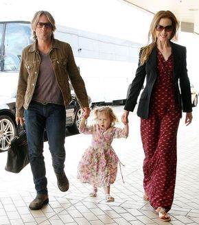 Keith Urban and Nicole Kidman and Sunday Rose Depart Australia - before 2nd daughter came along. Love this family picture :)