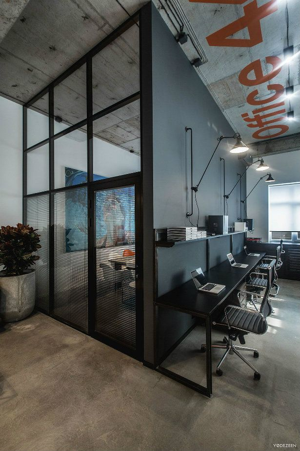 Industrial Interior Design Ideas modern industrial style deep colors complimented by wood flooring simple furniture and black Offices With An Industrial Interior Design Touch