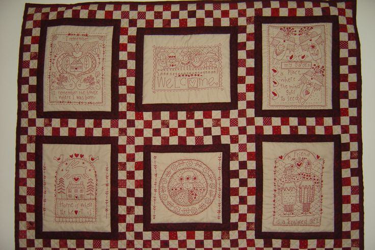 A red work embroidery quilt,