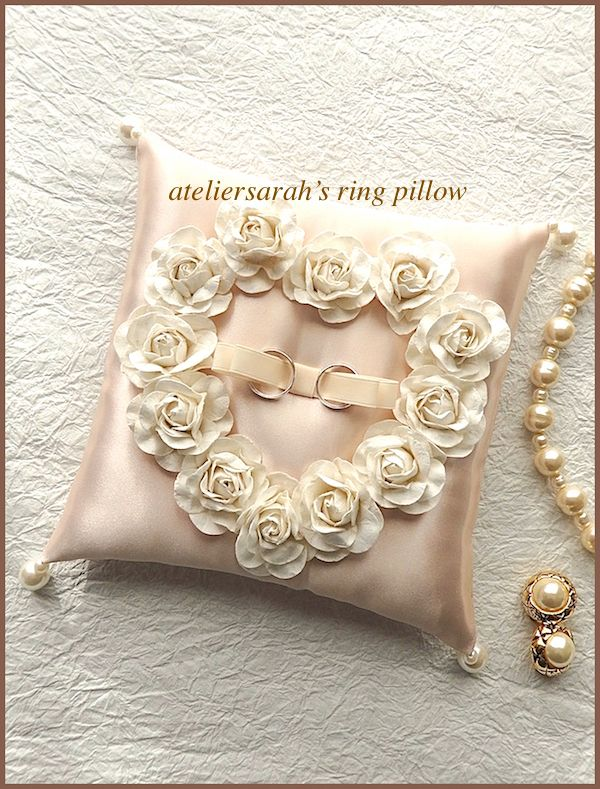 Beige rose color ring pillow decorating paper roses