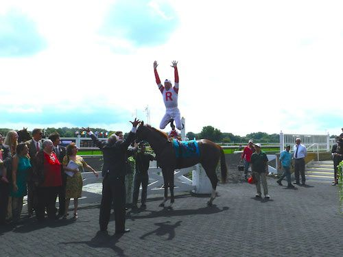 Frankie Dettori's signature flying dismount... into the arms of owner Ken Ramsey!