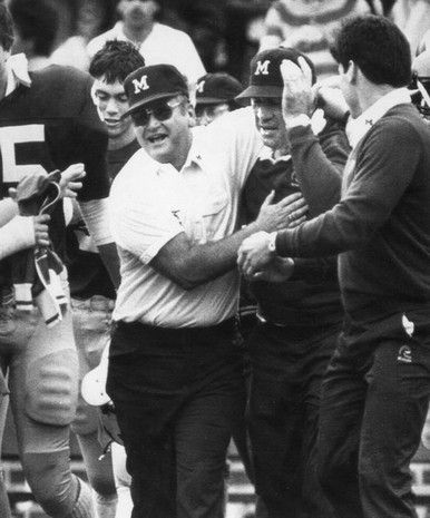 Bo Schembechler University of Michigan football hugs assistant Gary Moeller Saturday Oct. 27,1984 as the Wolverines beat Illinois 26_18 in Ann Arbor Michigan ............................... | freep.com | Detroit Michigan Wolverines | Detroit Free Press