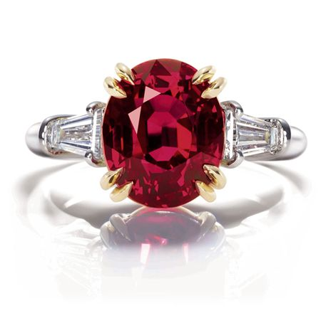 Oval Ruby Ring  Oval ruby, 5.40 carats; 2 tapered baguettes, 0.58 carats; platinum and yellow gold setting.
