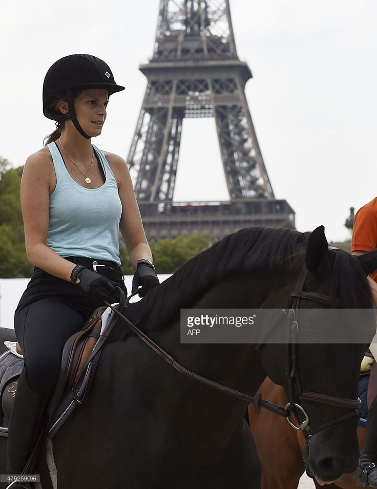 Greek shipping magnate Aristotle Onassis' heiress, Athina Onassis Roussel rides her horse in Paris on July 2, 2015, on the eve of the beginning of the second edition of the Longines Paris Eiffel Jumping tournament. The tournament runs from July 3-5. AFP PHOTO / LOIC VENANCE